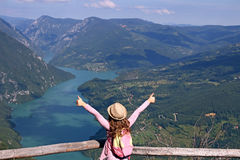 Little girl hiker with thumbs up Stock Image