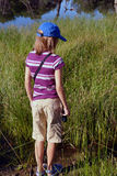 Little Girl Hiking. In a meadow Royalty Free Stock Image