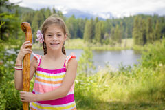 Little girl hiking in the mountains on a family vacation Royalty Free Stock Images