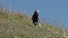 Little girl hiking in the nature stock footage