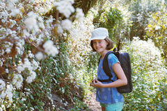 Little girl hiking. Pretty little girl hiking on a path covered with white flowers stock photos