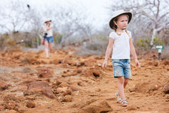 Little girl hiking at scenic terrain Stock Photos