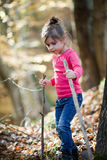 Little girl hiking in the woods Royalty Free Stock Images