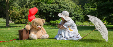 Little girl with his best friend talking together about problems Royalty Free Stock Photo