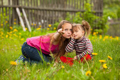 Little girl with his sister in the park Stock Photo