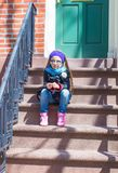 Little girl in historic district of West Village. Old houses with stairs in historic district of West Village Royalty Free Stock Photography