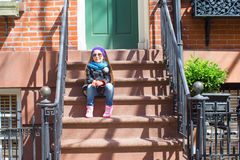 Little girl in historic district of West Village. Old houses with stairs in historic district of West Village Royalty Free Stock Photos