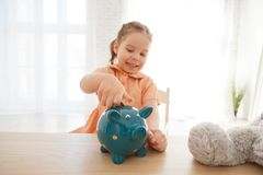 Little girl is hoarding the money.  royalty free stock photo