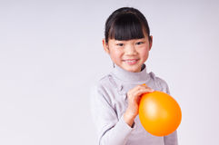 The little girl  Hold a balloon Royalty Free Stock Image