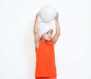 Little girl hold her ball on her head. Royalty Free Stock Image
