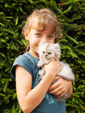 Little girl hold kitten of persian cat Royalty Free Stock Image