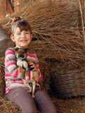 Little girl hold little puppy pet Stock Photos