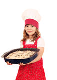 Little girl hold plate with bread Stock Image