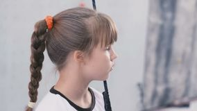 Little girl hold to the rope and looks away stock video footage