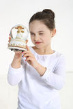 Little girl holding. Glass angel figurine Stock Photography