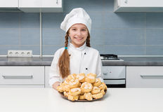 Little Girl Holding A Bowl With Homemade Cookies Stock Image