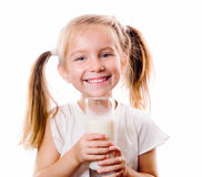 Little Girl Holding A Cup Of Milk Royalty Free Stock Photos