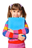 Little girl holding abig book Royalty Free Stock Image