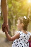 Little girl holding adult hand Royalty Free Stock Image