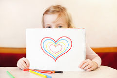 Little girl holding album with hearts. Valentine's Day Royalty Free Stock Photography