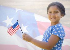 Little girl holding american flag against american flag royalty free illustration