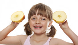 Little girl holding an apple Royalty Free Stock Photo