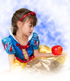 little Girl holding apple in snow white costume Royalty Free Stock Photo
