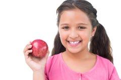Little girl holding apple in her hand Stock Photo