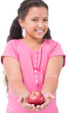 Little girl holding apple in her hands Stock Images
