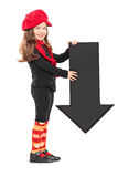 Little girl holding an arrow pointing down Stock Photography
