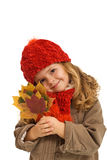 Little girl holding autumn leaves Royalty Free Stock Photos