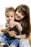 Little girl holding baby Royalty Free Stock Photo