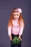 Little girl holding  ball in the studio Stock Photo