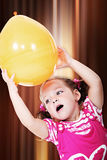 Little girl holding balloon Royalty Free Stock Image