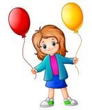 Little girl holding balloons Stock Images