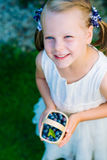 Little girl holding a basket of blueberries - shallow depth of f Royalty Free Stock Photography