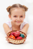 Little girl holding a basket with dyed easter eggs. Little girl holding a basket with dyed and decorated easter eggs - shallow depth Stock Photography