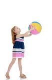 Little girl holding a beach ball in his Stock Images