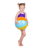 Little girl holding beach ball isolated Stock Photos