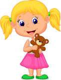 Little girl holding bear stuff Stock Photography