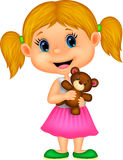 Little girl holding bear stuff Royalty Free Stock Image