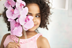 Little girl holding a beautiful flower Stock Photo