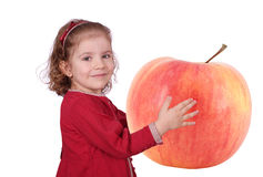 Little girl holding big apple Royalty Free Stock Photography