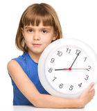 Little girl is holding big clock Stock Photography