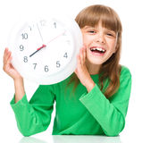 Little girl is holding big clock Royalty Free Stock Photo