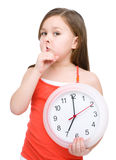 Little girl is holding big clock Stock Images