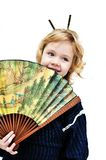 Little girl holding big fan Stock Images