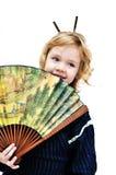 Little girl holding big fan stock images