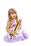 Little girl holding big pencil Stock Image