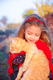 Little girl holding a big red cat Royalty Free Stock Photo